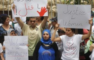 Lebanese Women's Democratic Gathering organize a demonstration against domestic violence